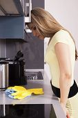 Pretty Woman By Cleaning In The Kitchen
