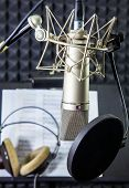 foto of singer  - Condenser microphone prepared for singer in vocal recording room - JPG