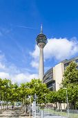 Dusseldorf, Germany, on July 6, 2014. Television tower against the bright blue sky. The Rhine tower