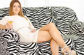 Beautiful Young Woman Relaxing On Sofa