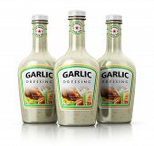 Set of bottles with garlic dressing