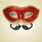 picture of a carnival mask with a fake nose and moustache on a beige background, with a retro effect