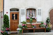 GRUYERES, SWITZERLAND - JULY 8, 2014: Front door on traditional Swiss home. The picturesque  home is