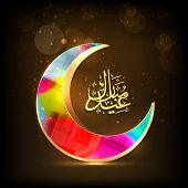 Arabic islamic of golden text Eid Mubarak with colorful moon on shiny brown background for Muslim co