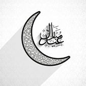 Beautiful crescent moon with arabic islamic calligraphy of text Eid Mubarak on grey background.