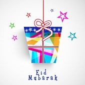 Hanging colorful gift box on stars decorated grey background for muslim community festival Eid Mubar