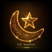Golden moon and star on brown background for muslim community festival Eid Mubarak celebrations.