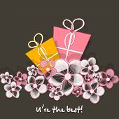 Happy Friendship Day celebrations concept with colorful gift boxes on floral decorated grey backgrou