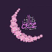Beautiful pink flowers decorated crescent moon with arabic islamic calligraphy of text Eid Mubarak o