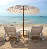 Thailand - White Sandy Beach With Loungers And Umbrellas