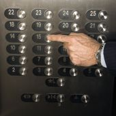 Hand Pushing Elevator Button