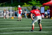 American Football Player With Out Of Focus Players In The Background