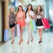 Four Happy Women Returning From Shopping