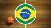 Basketball court parquet floor center with flag of Brazil
