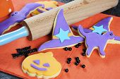 Happy Halloween Orange And Purple Sugar Cookies In Cat, Hat, Bat And Pumpkin Shapes With Rolling Pin