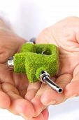 hand holding green fuel nozzle