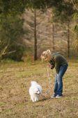 Girl Walking Her Dog