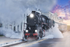 foto of train-wheel  - Retro steam train departs from the railway station at sunset - JPG