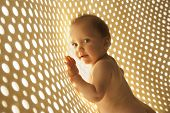 naked baby with rays of light network