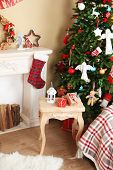 Decorated fireplace near Christmas tree. Christmas decoration concept