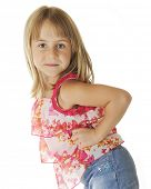 Close-up of an adorable elementary girl working up the sassy.  On a white background.