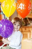 Happy Little Boy Celebrating His 4 Birthday With Colorful Balloons