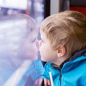 Beautiful Toddler Boy Looking Out Train Window Outside