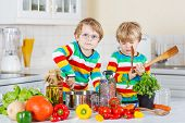 Two Cute Little Brothers Cooking Italian Soup And Meal With Fresh Vegetables