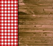 Wooden background with red tablecloth