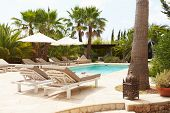 Luxury Hotel Swimming Pool With Loungers