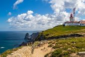 picture of promontory  - The Cabo da Roca lighthouse overlooking the promontory towards the Atlantic Ocean - JPG
