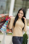 Beautiful woman with colored paper bags