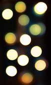 Blurred bokeh lights background in golden tones