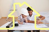 Father and son studying working with plans against house outline