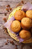 Orange Muffins In A Basket And Raisins Top View Vertical