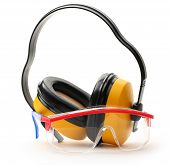 picture of protective eyewear  - Transparent protective goggles and earphones in closeup - JPG