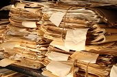 Paper Documents Stacked In Archive