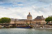 Seine River Coast With Facade Of Institute De France In Paris