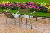 Wet Metal Armchairs In The Rainy Park,  Paris