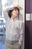 image of measuring height  - Boy checking height on growth chart at home on doorframe - JPG
