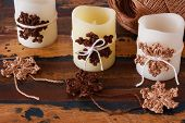 Christmas Handmade Decoration Of Candle With Brown Crochet Snowflakes