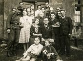GERMANY, CIRCA 1930s- vintage photo of family posing outdoor