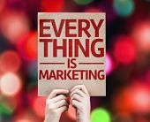 Every Thing is Marketing card with colorful background with defocused lights