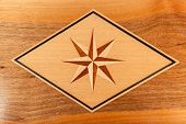Wood Eight-pointed star in a rhombus isolated over wood background