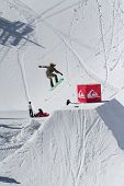 SOCHI, RUSSIA - MARCH 22, 2014: Snowboarder jumps in Snow Park,  mountain ski resort Rosa Khutor.