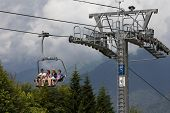 SOCHI, RUSSIA JULY 23, 2015: Tourists on the ski lift, mountain resort