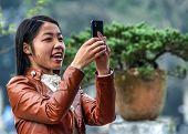 Young Vietnamese Woman Takes A Selfie.