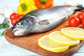 Fresh raw fish and food ingredients on table