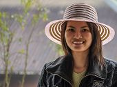 Young Vietnamese Woman With Fancy Hat.