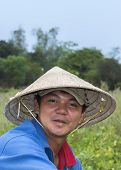 Face Of Young Vietnamese Farmer Near Hoi An.